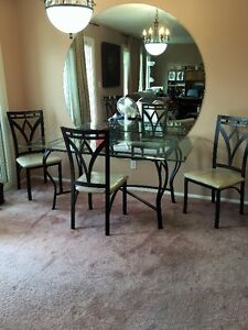 Beautiful Beveled Glass Table and iron chairs