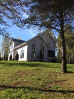 ONE OF A KIND COUNTRY HOME WITH ACREAGE