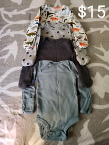 Lots of brand name like-new baby clothes
