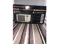 Brand new Cream Russell Hobbs microwave