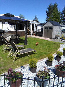 Rv park model trailer and lot for sale