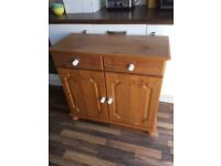 Pine dresser cabinet / Tv cabinet. The cabinet has white handles, and bun feet.