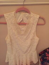 Lace top with added pearl necklace