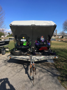 Snow mobile trailer and sleds