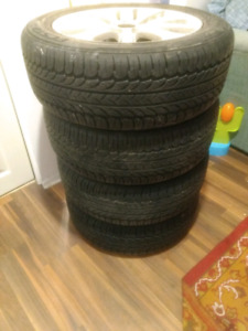 Almost new all seasons tires 205/55/R16 new tires on mags