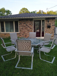 Glass top Patio table & 6 chairs