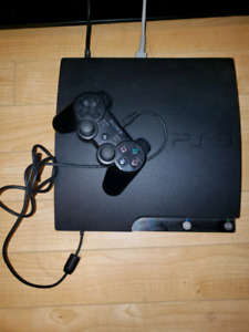 Play Station 3 - 2 Controllers + 5 Games