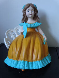 Little girl on a bench, 13 inches tall by 10 inches wide