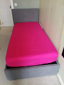 New single ottoman storage bed. Grey