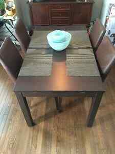 Ikea Bjursta Table and 8 Faux Leather Chairs - Good Condition