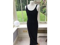 Stunning sequin long black dress with weighted split detail at the back zip and clasp