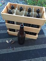 81 L beer bottles and carrying case