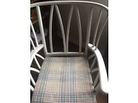 What is believed to be Ercol solid wood occasional chair