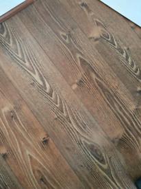 Brown Oak Effect Laminate Flooring.