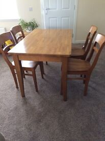 Table and chairs - dark wood -chestnut colour