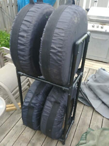"Lightly used 14"" tires on rims,carrying cases and storage rack"