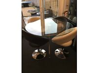 Dwell glass table and 4 retro leather circle chairs