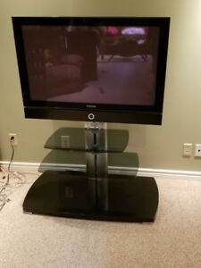 Sanus mounting TV stand with TV.