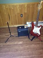 Slammer guitar with Nova amp and two stands