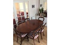 Dark wood extending table and 6 chairs