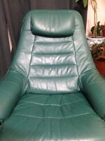 2 green leather chairs