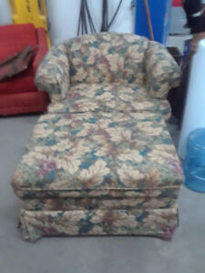 Beautiful floral chair and matching storage capable ottoman.