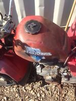 Big red three wheeler for hole or parts