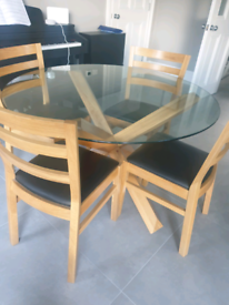Oak and glass round dining table and chairs