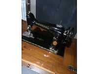 Electric Singer sewing machine with table