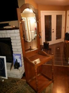 front door table with mirror and hooks