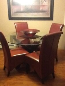 Glass round table with 4 red chairs