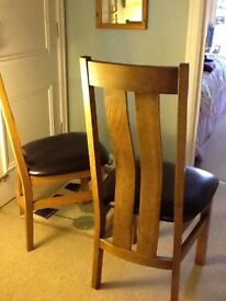 Two solid oak dining chairs