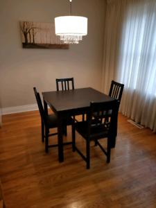 Black fold-out dining room table w/ chairs
