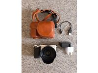 Sony a6000 w/ 35mm f.18 OSS lens and brown leather carry case