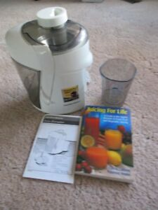 Hamilton Beach Juicer with instruction book, and recipe book