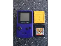 Game boy color with POKEMON yellow and speedy gonzales