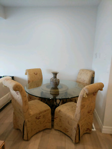 Glass Dinette w 4 chairs.  Great condition.