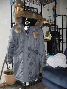 Ladies winter jackets, one grey and one grey