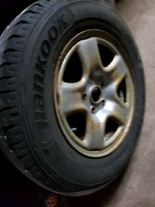 215/70/16 winter studded tires on rims