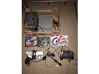 PlayStation with accessories and games