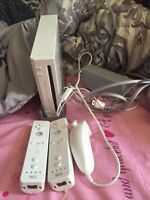 Wii with two remotes, a nunchuck and sensor bar