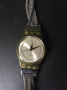 Swatch new battery and this is a rare one 60$ London Ontario image 1