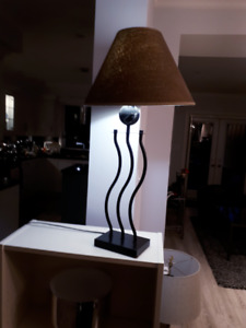 Table lamp with modern metal and marble stand and brown shade