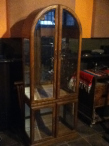 Beautiful Arched top Display cabinet with mirror back and light