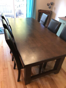 Solid wood dining room table and 8 chairs