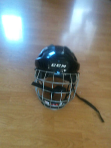 Hockey helmet with face cage