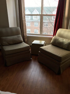 TWO ARMLESS LOUNGE CHAIRS
