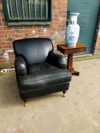 Beautiful leather armchair in the style of Howard & Sons