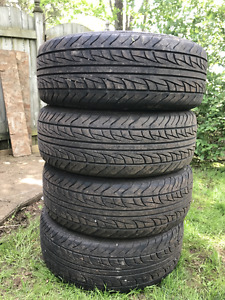 4 Uniroyal Tiger Paws tires 215/60R16 95T  $140.00