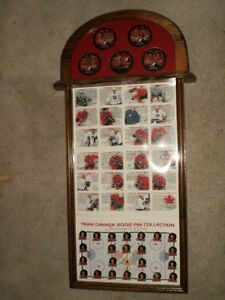 2002 olympic team canada gold medalist pin and puck set